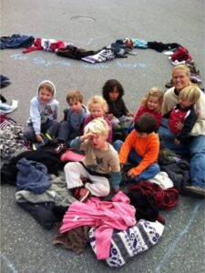 Jennifer Borzel and her preschool-aged students gathered nearly 100 sweaters for Sweaters for Syria. Photo: Breana Curnow.