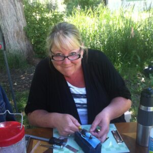 Caren Pritchard hard at work at her hummingbird banding station in Quesnel July, 2013. Photo by Diane Dunaway