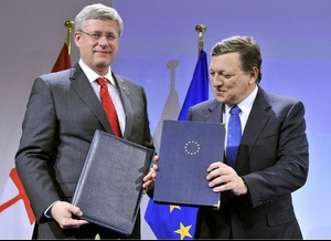 Prime Minister Stephen Harper and European Commission President Jose Manuel Barroso signed a free-trade accord last week. Now negotiations must proceed on a prickly side deal. Photo: Georges Gobet