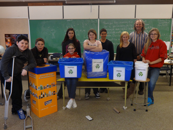 Mr. Kowalski's Grade 7-9 class standing next to the recycling and composting containers at Horsefly Elementary Junior Secondary School. The students also produced a video and submitted it to the BC Green Games competition. From left to right: Cody Mack, Jacob Helminger, Katie Isaac, Leanna Gasser, Teala Sumner, Cristian Pena Angulo, Jessica Alcock, Rob Kowlaski, and Kylie Lacey.