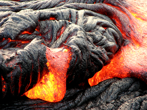 Pahoehoe lava flowing to the ocean from its source at the Puʻu ʻŌʻō vent of Kilaeua Volcano on the southeast coastline of Hawai`i. Photo: Lisa Bland