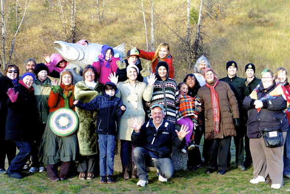 Group photo from the Honour Ceremony for Rivers, Salmon, and People in McMillan Creek Fishing Park in Prince George where four prayer pots were buried. Photo: Helen Styles