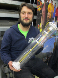 Sam Albers, from the Quesnel River Research Centre holding  equipment for taking water samples.  Photo: Sage Birchwater