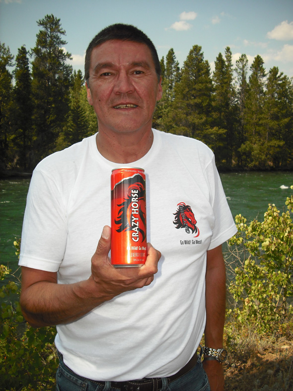 Tsi Deldel Chief Percy Guichon holding Crazy Horse energy drink. Photo: Sage Birchwater