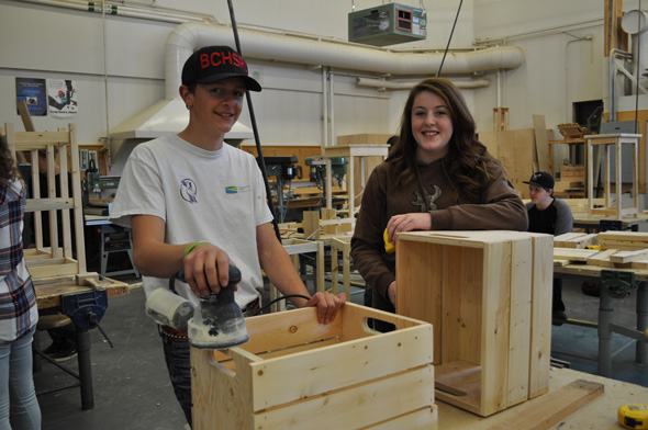 Wyatt Armes and Madison Fraser, Grade 10 students at the Wil- liams Lake woodworking class, display beautiful wooden crates that will be sold at the Medieval Market to raise funds for the program. Photo: LeRae Haynes