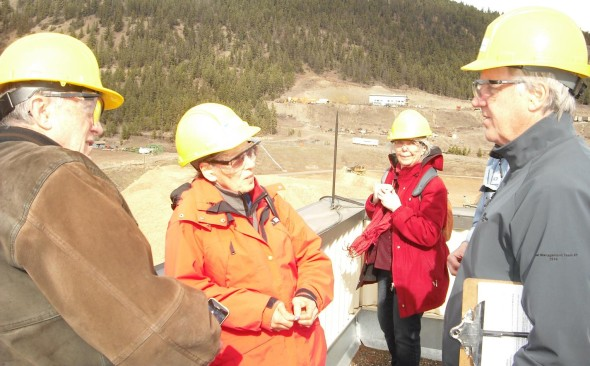 From the roof of the Atlantic Power Corporation energy plant in Williams Lake, Terry Shannon, the company's director of environmental health and safety, right, offers a tour of the facility to Jim Hilton, Sandy Hilton, and Caterina Geuer. Photo: Sage Birchwater