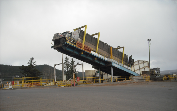 Truck dumping clean residual fibre at Williams Lake Power Plant - Photo: Sage Birchwater