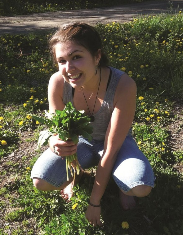 Kristin with freshly harvested wild dandelion greens. Photo credit: Vera Lehar