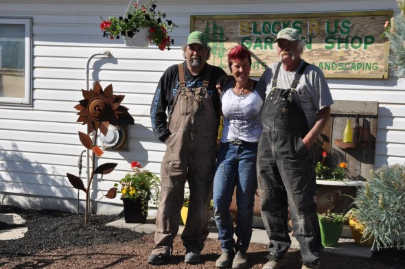 Fred Ball, Bridget Lusignan and Wayne Ball at Bridget's Rustic Garden at Block R Us, where planters, fountains and garden decor are created to embellish and delight.  Photos: LeRae Haynes