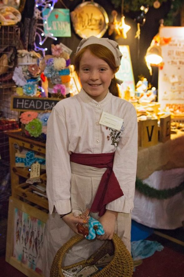 Young medieval market helper at the Vintage Soul booth. Photo: Kylie Forseille, Still Reality Photography