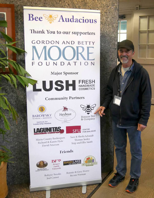 Making it possible. Bee Audacious co-founder Gary Morse stands next to a banner of conference sponsors. Photo: Sierra Salin