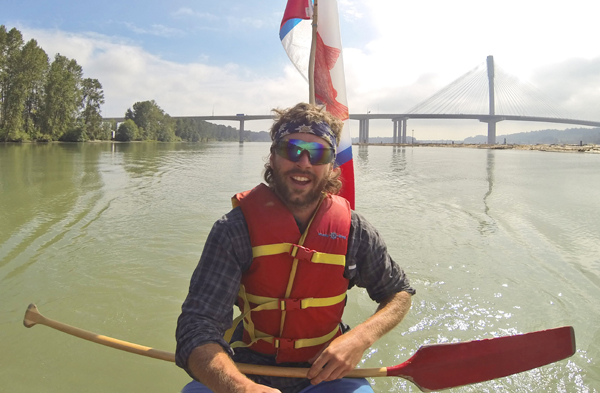 Lower Fraser River. As the crew heads back into the grip of civilization, Oliver Berger takes a moment at the helm to catch a selfie with the Port Mann bridge. Photo: Oliver Berger