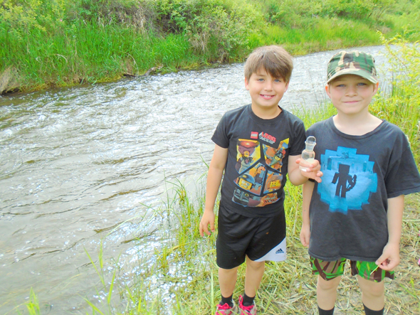 Grade 3/4 students from Peta-Sue Silver's class at Nesika Elementary at the Williams Lake River conducting water quality testing. Photo by Jenny Howell
