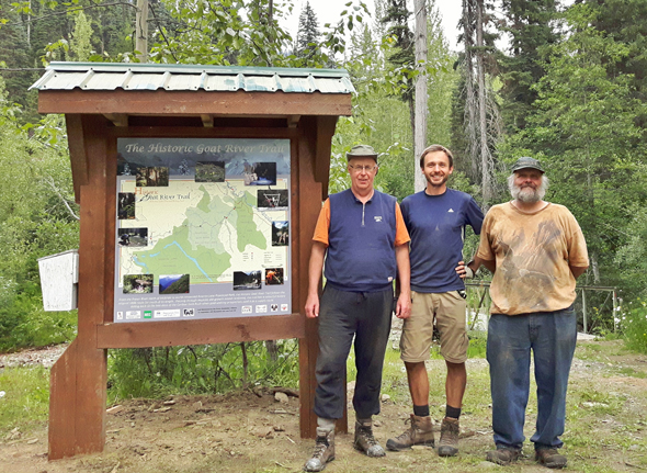 Newly installed Kiosk at the Littlefield Creek Trailhead, near Bowron Lake Provincial Park. From left to right: Al Birnie, Simon Zukowski, and Roy Howard (president of the Fraser Headwaters Alliance).