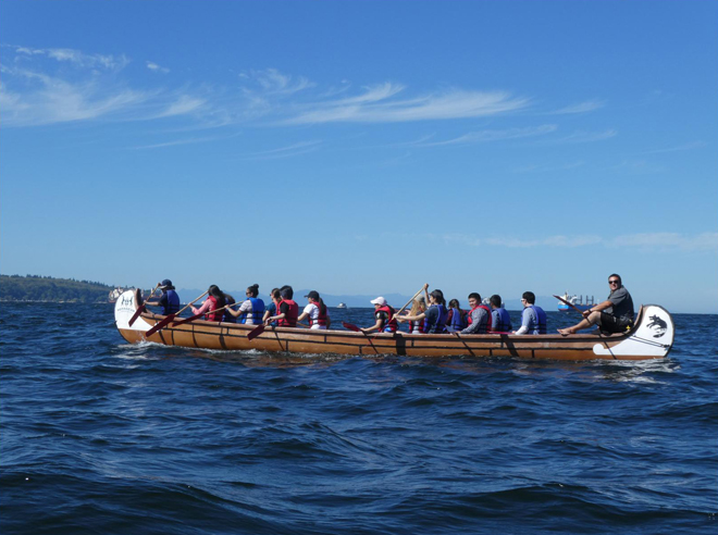 Paddling on Voyageur canoes in English Bay, Vancouver during the Pink Salmon Festival, August 2017. Photo: Lisa Bland